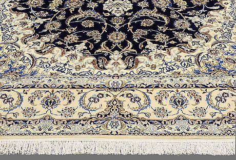 A carpet, nain part silk, so called 9 laa, ca 355 x 251 cm.