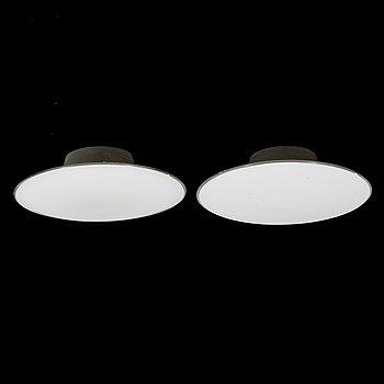 "ARNE JACOBSEN, A PAIR OF WALL LAMPS / CEILING LAMPS, ""AJ-Eklipta"", Louis Poulsen/ license Orno1960s."