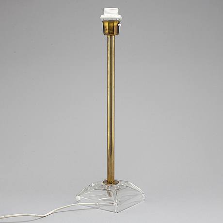 Carl fagerlund, a brass and glass table lamp, orrefors