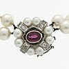 Pearl necklace 2 rows of cultured pearls approx 7 mm, clasp in 18k whitegold w 1 ruby (possibly synthetic)