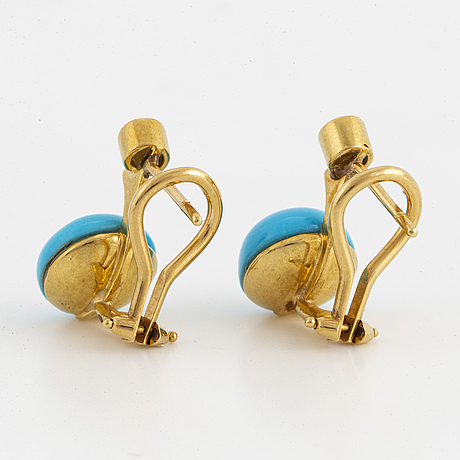 A pair of 18k gold earrings set with brilliant cut diamonds