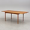 A teak veneered dining table, second half of the 20th century