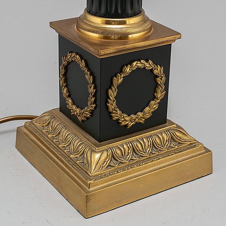 A modern empire-style table lamp.