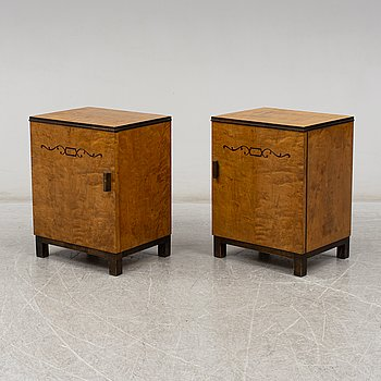 A pair of 1930's bedside tables.