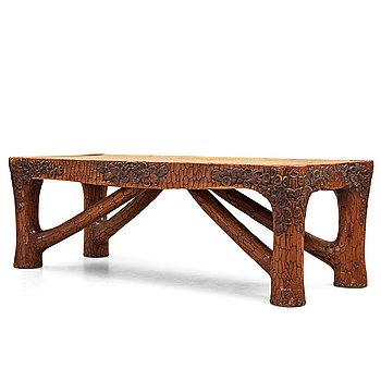 232. Gustaf Fjaestad, an Art Nouveau carved pine table, Arvika Sweden 1914, a double to the table in the Thiel Collection,