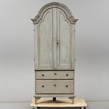 A 18th Century Rococo corner cabinet.
