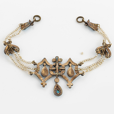 A silver bracelet, partly gilded, with turquoises and pearls