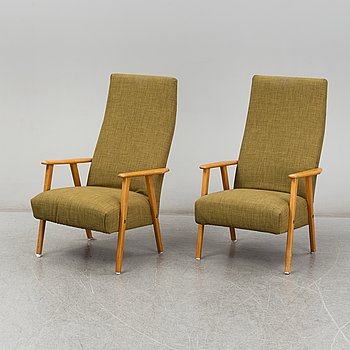A pair of beech easy chairs, 1950's/60's.