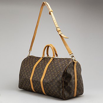 LOUIS VUITTON, a monogram canvas weekendbag 'Keepall Bandouliere 55'.