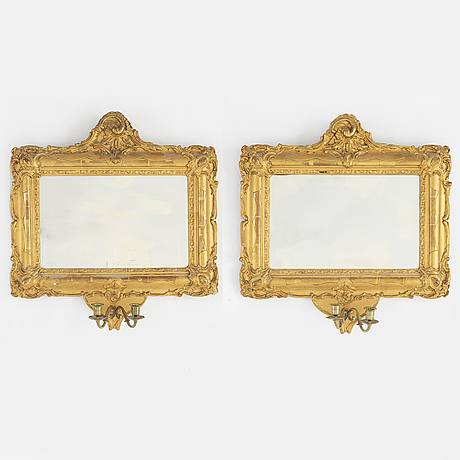 A pair of late 19th century giltwood girandole mirrors.