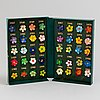 A collection of swedish may flower pins, 1907 1986