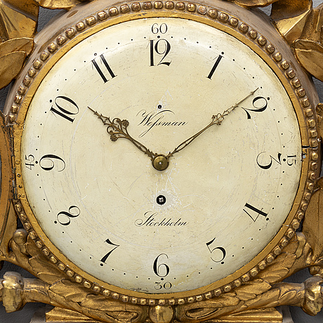 Hans wessman, a gustavian gilt wood wall clock, stockholm, active 1787-1805.
