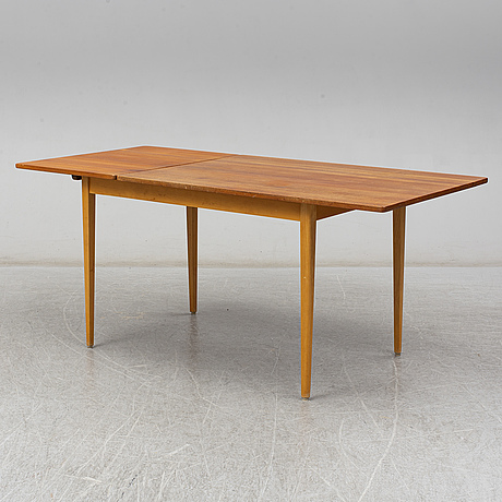 A 1960s teak veneered dining table