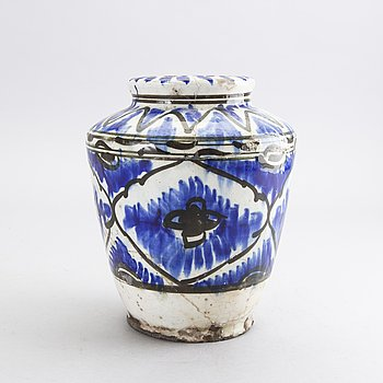 A probably late Qajar earthenware urn height 23 cm.