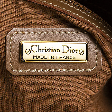 Christian dior, a canvas and leather weekendbag.