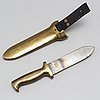 A brass diver's knife from c.e. heinke & co. ltd., london, england.