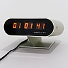 A 1970s digital quartz tag heuer desk clock, brushed aluminium.