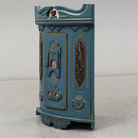 A swedish 19th century corner cabinet