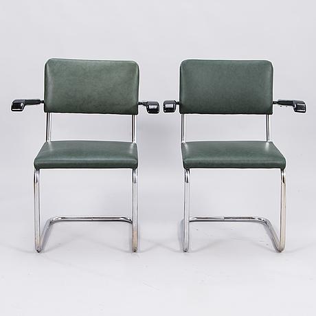 A pair of mid 20th century armchairs for j. merivaara, helsinki.