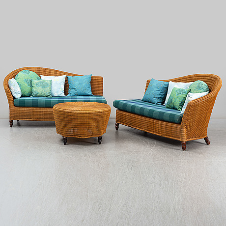 Two rattan daybeds and a table, late 20th century.