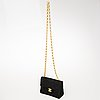 Chanel black suede mini flap bag.
