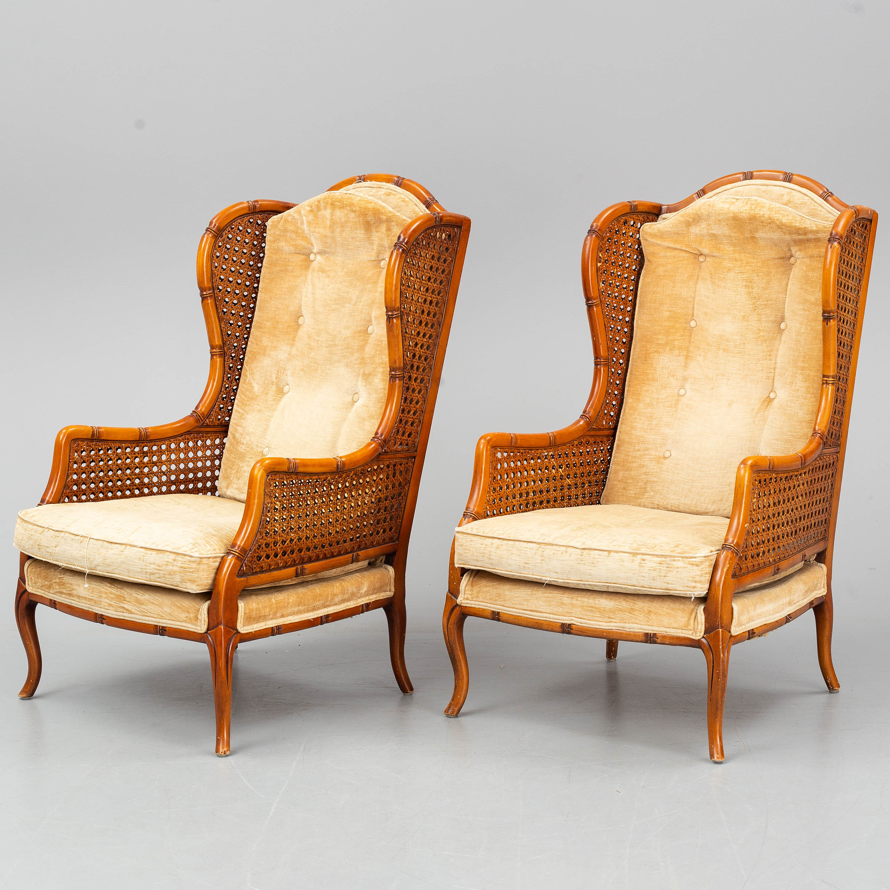 Fabulous A Pair Of Colonial Style Rattan Wing Chairs Late 20Th Ibusinesslaw Wood Chair Design Ideas Ibusinesslaworg