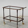 A mahogany serving trolley from the second half of the 20th century.