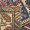 An antique shirvan carpet ca 294 x 108 cm.