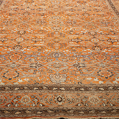A carpet, antique tabriz, ca 381 x 284 cm.