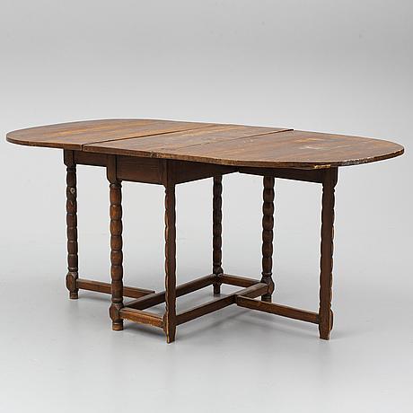 A 19th century gate leg table.