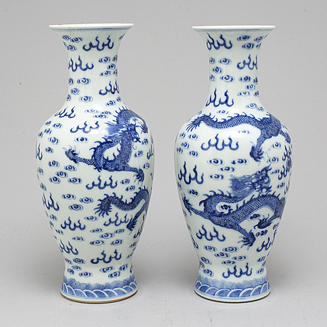 A pair of chinese blue and white dragon vases, early 20th century, with a qianlong mark.