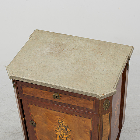 A gustavian style bedside table, early 20th century.