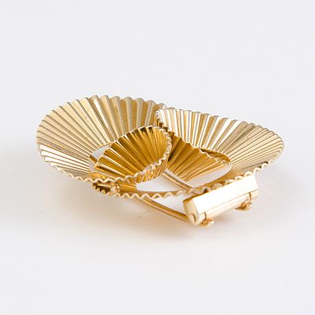 Cartier, a 14k gold brooch . marked 289c.