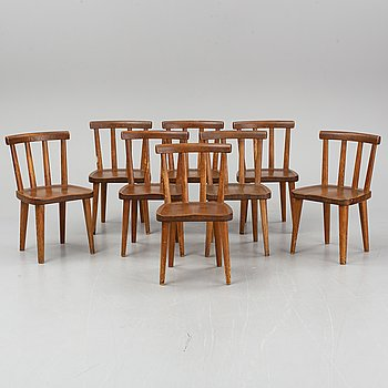 "AXEL EINAR HJORTH, a set of eight ""Utö"" stained pine chairs, Nordiska Kompaniet, Sweden 1930's."