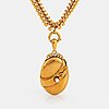An 18k gold locket set with a pearl and an 18k gold chain.