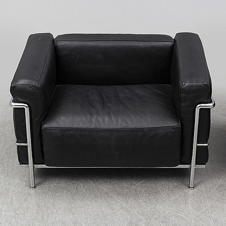 Le corbusier & charlotte perriand, a pair of 'lc3' leather and steel easy chairs, cassina