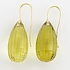 A pair of large drop shaped briolette-cut lime quartz earrings.