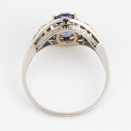Platinum and oval faceted sapphire and old-cut diamond ring.