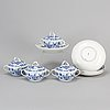 Four 'blue onion pattern' porcelain serving bowls with cover and dishes, meissen, 20th century