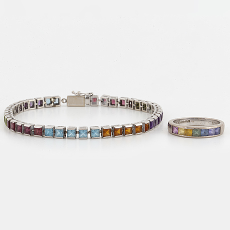 White gold bracelet and ring with coloured stones.