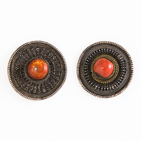 A pair of indian silver ear buttons and buttons before 1960:s