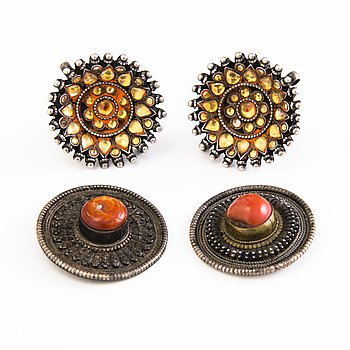 A pair of Indian silver ear buttons and buttons before 1960:s.