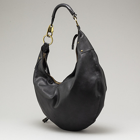Gucci, a black leather bag with pochette