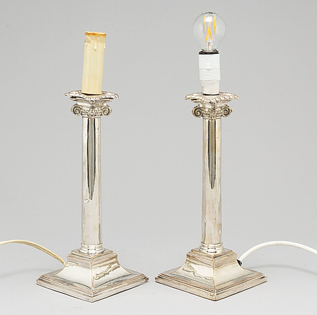 A pair of silver plated candle holders made as table lamps, 20th century.