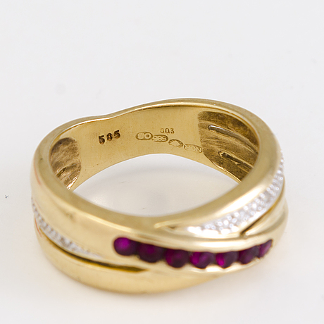 A ring in 14k gold with diamonds and rubies, end of 20th century