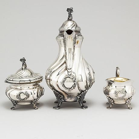 Cg hallberg, a three piece silver rococo style coffee service, stockholm, 1947 74
