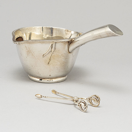 A mexican sterling silver sauce pan and a georg jensen sugartangs, 20th century.