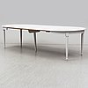 A mid 20th century painted dining table