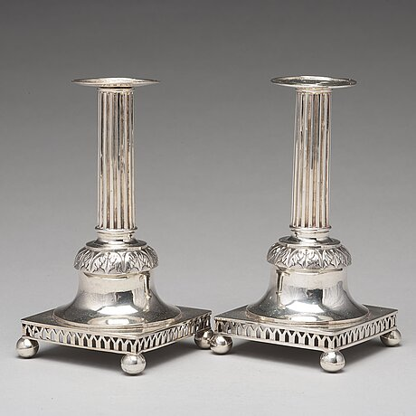 A pair of swedish aerly 19th century silver candlesticks, mark of carl gustaf blomborg, stockholm 1815.