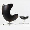 "Arne jacobsen, a black leather ""egg"" chair with ottoman, fritz hansen, denmark 1960's."